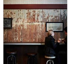 Rejuvenation Salvage Sighting: Corrugated iron clad walls in Bowery Cafe New York