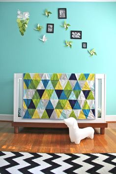 custom triangle quilt. $150.00, via Etsy- iviebaby
