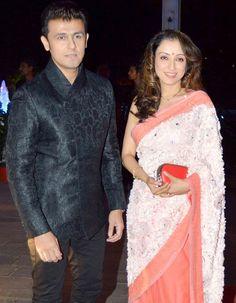 Sonu Nigam and wife Madhurima at Tulsi Kumar's wedding reception in Mumbai. #Bollywood #Fashion #Style #Beauty