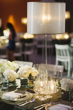 Glass elements surrounded by small votives add a touch of sparkle to reception tabletops.