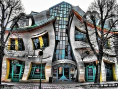 Sopot, near Gdansk. The Krzywy Domek is an irregularly-shaped building in Poland. Its name translates in to English as the Crooked House. The Krzywy Domek was built in Unusual Buildings, Interesting Buildings, Beautiful Buildings, Beautiful Places, Sopot Poland, Houses In Poland, Architecture Unique, Crooked House, Crooked Tree