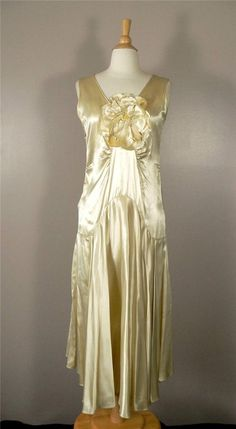 gorgeous orig. 1920's cream silk~satin flapper dress w/ gather & dramatic satin flower detail........