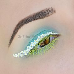 Happy Earth Day! used: NYX Professional Makeup white liquid eyeliner vivid brights liquid eyeliner in Halo and their colored mascara in Perfect Pear. Sugarpill Cosmetics Pressed eyeshadow in Mochi on the lid by ahitsrosa