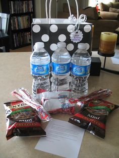 Contents of Welcome Bags for hotel guests. Water, pretzels, licorice, rice krispies, welcome note/itinerary