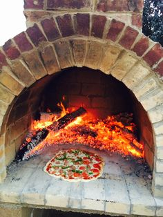 Outside wood burning oven. Best way to cook pizza. Definitely want one in my future home .
