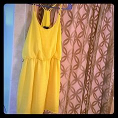 Bright yellow dress Bright yellow City Triangles dress, perfect for summer! Never worn tags still attached. City Triangles Dresses