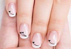 Acrylic Nails with Black Hearts for Valentine's Day Nail Art