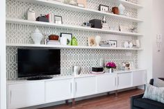Great shelving unit. (Open concept condo tour from HGTV.)