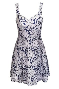 Denim Daisy Dress from Single Dress. Denim dress with mesh daisies and sweetheart neckline. Lined in cotton stretch sateen. $139