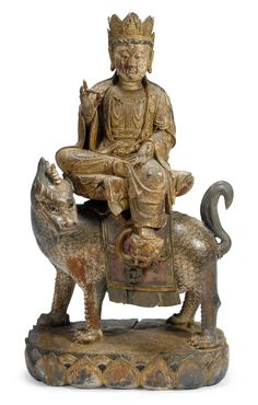 Chinese polychrome wood figure of Ksitigarbha bodhisattva on Unicorn Beast , Ming dynasty. Sold for Sold for $110,000 @Susan Burns's