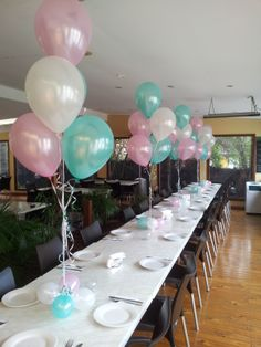 Pretty table arrangements for a young ladies 16th birthday! nice colour choices :)