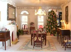 """A Christmas tree stands in the mirrored corner of the dining room. She said:I made the small table of cherry and holly wood in a Randy Himes class. The cellarette and sideboard were souvenirs from Ashland """"Back-to-College weekends."""