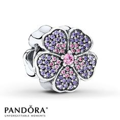 Pink and purple cubic zirconias add shimmer and color to petals on both sides of this sterling silver charm from the PANDORA Spring 2015 collection. Style # 791481PCZ.