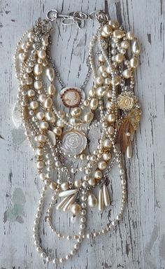 """From the """"more is more"""" mentality: give random, vintage, or estate sale necklaces new life by teaming them up together.  Lovely and evocative!"""