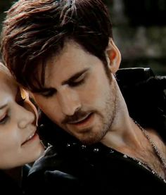 You can see Emma is just completely open and enjoying the moment of closeness with him, as well as a slight impishness because she knows the power she wields over him, even if he doesn't. That brings me to him; he has no clue who this woman is, yet from the very first moment he ran into her (literally), he felt something. It's unbelievable how instant and complete his connection to Emma is, no matter how many different times and places he meets her.