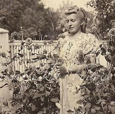 ON SALE Vintage Photo - Young Woman in Floral Print Blouse in a Flower Garden - Curler Roll Hair Curls, Pet Dog at Her Feet - Europe 1940s. $3.49, via Etsy.