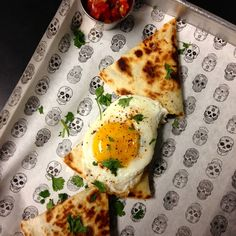 Today's Veggie Quesadilla is the perfect Monday pick-me-up. Roasted mushrooms, sautéed onion and spinach, cheese blend, and a side of pico, topped with a fried egg.