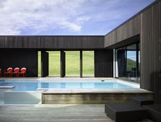 Completed in 2009 in Muriwai, New Zealand. Images by Simon Devitt, Jean Luc-Laloux. The ancient architype of The Castle as an Outpost or Fort is rarely articulated in the modern world. This New Zealand farmhouse project explores this. Residential Architecture, Modern Architecture, Amazing Architecture, Home Interior Design, Interior Decorating, Unusual Homes, Cool Pools, Prefab, Simple House