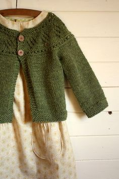 Sweater is the Mini Chic sweater by Katie White. Pattern available through Ravelry http://www.ravelry.com/patterns/library/mini-chic