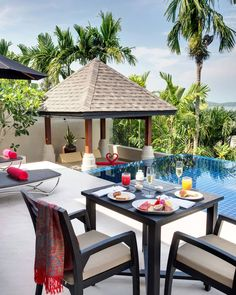 The Pavilions Phuket Choeng Thale, Thailand Beachfront Dining Luxury Modern Pool tree chair property home Villa cottage Resort backyard outdoor structure