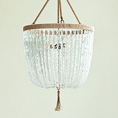 "how pretty is this super expensive chandelier!  serena and lily    Uses two 60W bulbs. 18"" DIAM x 24"" H, excluding tassel. 18"" DIAM x 29.75"" H, including tassel. Optional 36"" chain included. (Item # LA-H10)    Quantity:      $1,500.00"