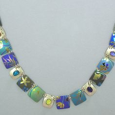 """SKU: HY 96170 Necklace composed of amethyst, hessonite, citrine,and dichroic glass on niobium and gold fill with a gold overlay box clasp. Measures 18 1/4"""" long."""