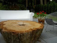 Hi AT,  A few blocks from me, I saw an old oak tree being cut down and asked if I could have the stump.  I brought it over to my backyard and now use it as a table.   I was wondering should I treat it or just leave it alone?...  (Note: Include a pic of your problem and your question gets posted first. Email questions and pics with QUESTIONS in subject line to:editor(at)apartmenttherapy(dot)com)Link To All Good Questions