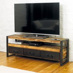 This Large Widescreen TV Cabinet, which will fit a screen of up to 80in is from the exclusive Urban Chic range and is made using reclaimed wood salvaged from old boats and buildings in southern India. This unit has a shelf designed to store all those ancillary units such as DVD player, Sky box etc. The shelf's dimensions are; H13 x W150 x D40 cm Three drawers beneath provide useful additional storage for DVD's or to hide remote controls, spare cables etc.