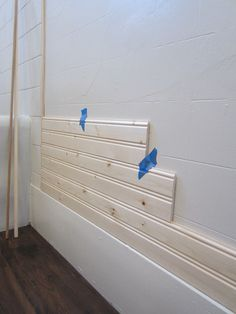 Vertical And Horizontal Wood Planks Installed On Bathroom Walls