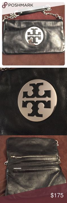 Authentic Tory Burch Reva Clutch Tory Burch black leather reva clutch with silver metal accents. Has detachable strap so you can wear either as shoulder bag or carry as a clutch. Zipper compartments on both the top and bottom of the bag. Some wear and tear but in overall great condition!! Tory Burch Bags Clutches & Wristlets