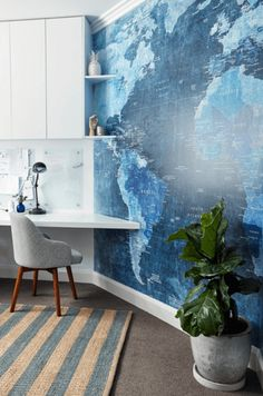 home office with blue map accent wall, pantone riverside, marine blue