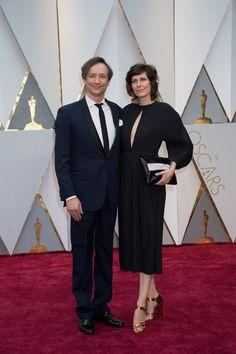 Oscar®-nominee, Hauschka and guest arrive at The 89th Oscars®. #Oscars #Oscars2017 #redcarpet #4chionStyle #dress