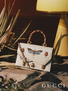 A look at the new Gucci Ottilia bamboo top handle bag with insect details from Gucci Fall Winter 2017.