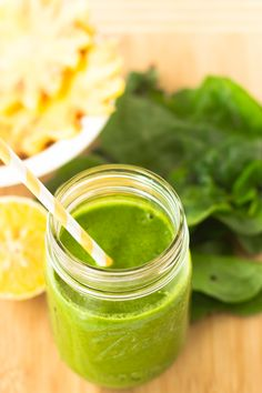 This Tropical Green Smoothie is one of my favorite quick and easy green smoothies - loaded with spinach, pineapples, orange juice and bananas. It's only 255 calories and deliciously smooth!