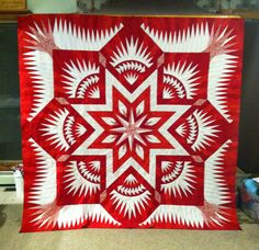 Red and White Prairie Star quilt. Looks completely different from the original. Made by Joanne Hubbard
