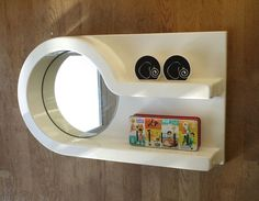 A supercool 60s 70s moulded plastic bathroom mirror with shelves. Vintage retro