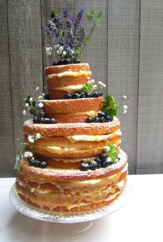 Wedding Cake Recipes Lemon and Lavender wedding cake - My Lemon, Lavender and Blueberry Wedding Cake was made in Canada, for special friends of mine who were getting married in Vancouver. The cake itself was a lemon victoria sponge, which I laced with a l Lemon Wedding Cakes, Floral Wedding Cakes, Wedding Cake Flavors, Unusual Wedding Cakes, Blueberry Wedding, Blueberry Cake, Lemon Sponge, Lavender Cake, Lemon Drizzle