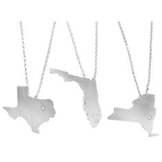 CUSTOM STATE NECKLACES. Silver with a diamond over your favorite city.    I want one!