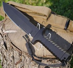 """This Robson RPW Model X-46 features one piece A2 tool steel construction with a black CeraKote finish. The 7"""" hollow ground tanto blade has a false top edge and is 1/4"""" thick. The fluted """"No Slip"""" oval hollow handle has an integrated guard, glass breaker tip and a steel pommel with two lanyard holes and a braided cord lanyard. The handle is air and water tight. This multi-purpose field knife is as useful on the battlefield as it is in the bush."""