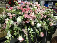 pretty lady  breathtaking array of pink standard roses, white standard roses, pink spray roses, pink alstromeria, pink larkspur, white snap dragons, white misty, mixed greens, and baby blue eucalyptus in a casket form.