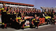 Davey Allison and his Robert Yates Racing team pose alongside the iconic No. 28 Ford.