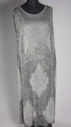 A pale grey georgette evening dress with crystal and gun-metal beading, over integral grey satin slip, circa 1926