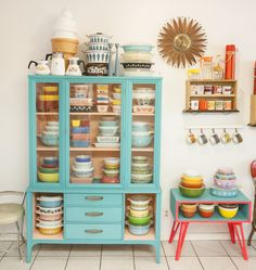 Amazing Pyrex collection in painted vintage cabinet. Contrasting painted side table. By Danny-Brito via a Beautiful Mess Blog