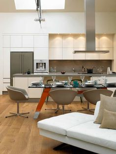 Modern Kitchen Design | David Churchill Architectural Photographer | White kitchen with wood floor, stainless steel appliances, great flow from kitchen to dining, elegant