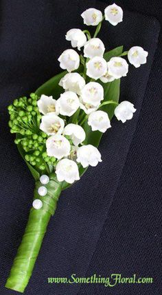 Groom's Boutonniere: Traditional Lily of the Valley.  Hard core!  That stuff is poisionous.  Maybe Michael would