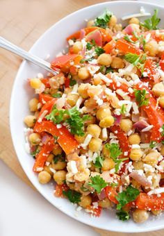 Mediterranean Chickpea Salad ~ takes less than 15 minutes to prepare, and has the most incredible flavors...also, packed full of fiber and protein, which will keep you feeling full for hours. | Haute & Healthy Living
