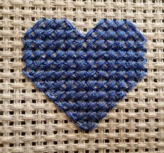 Sunday Stitch - HALF CROSS STITCH  Inspiration - Simple hearts like this could make a great background - use one of the whole pieces of the aida fabric as a page background?