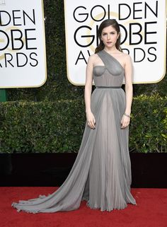 Anna Kendrick turned heads in a sea of black dresses in a sheer grey gown with a long train. We're totally loving this simple, yet sophisticated, ensemble. (Photo by Frazer Harrison/Getty Images)  via @AOL_Lifestyle Read more: http://www.aol.com/article/entertainment/2017/01/08/golden-globes-2017-red-carpet-arrivals/21650423/?a_dgi=aolshare_pinterest#fullscreen