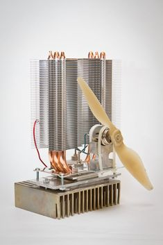 Peltier woodstove fan. The fan gets its power from a peltier element that is used in reverse, i.e. it is generating electricity from the heat given off from the stove top.