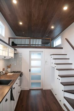 The storage stairs have a place for a washer/dryer combo and a pull-out first step. The stairs lead up to the guest bedroom loft.